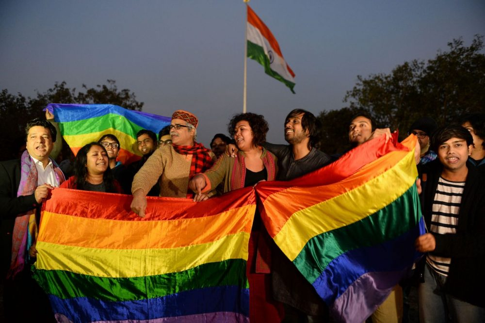 Indian gay rights activists celebrate after the country's Supreme Court agreed to review a decision which criminalises gay sex in New Delhi on February 2, 2016. India's top court agreed to review a decision which criminalises gay sex, sparking hope among campaigners that the colonial-era law will eventually be overturned in the world's biggest democracy.        (SAJJAD HUSSAIN/AFP/Getty Images)