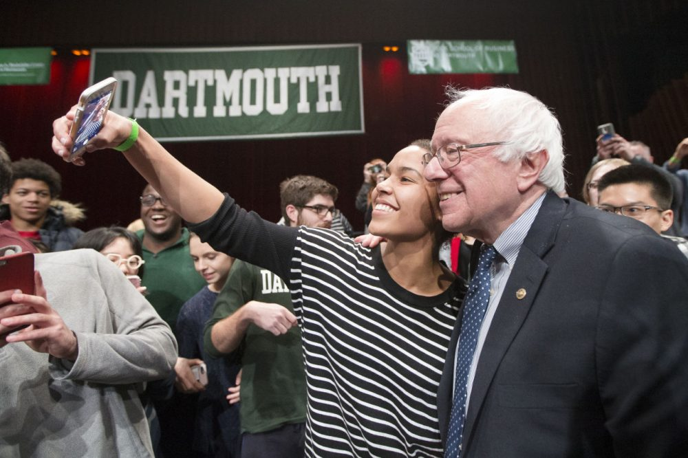 Democratic presidential candidate, Sen. Bernie Sanders (I-VT) has a selfie taken with an audience member after speaking at a campaign stop at Dartmouth College, Thursday, Jan. 14, 2016, in Hanover, N.H. (John Minchillo/AP)