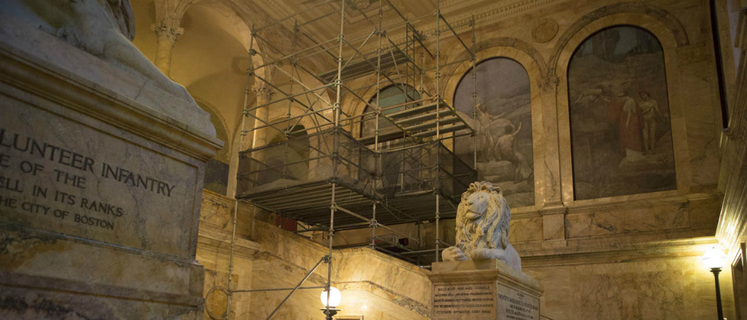 """Scaffolding is set up along the grand staircase in the Boston Public Library's Copley Square branch, ahead of an effort to rescue and restore the """"philosophy"""" mural. (Jesse Costa/WBUR)"""