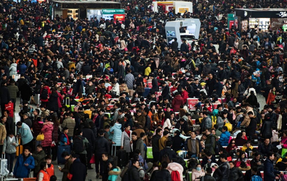 """Passengers crowd the Shanghai Hongqiao railway station as they wait to board their trains to head to their hometowns for the Lunar New Year holiday, in Shanghai on February 3, 2016. Over 2.9 billion trips will be made around China during the 40-day """"Spring Festival"""" travel rush, which kicked off on January 24, Chinese authorities estimated.  The Spring Festival, this year being the Year of the Monkey, China's most important holiday centering around family reunions, will fall on February 8.    (Johannes Eisele/AFP/Getty Images)"""