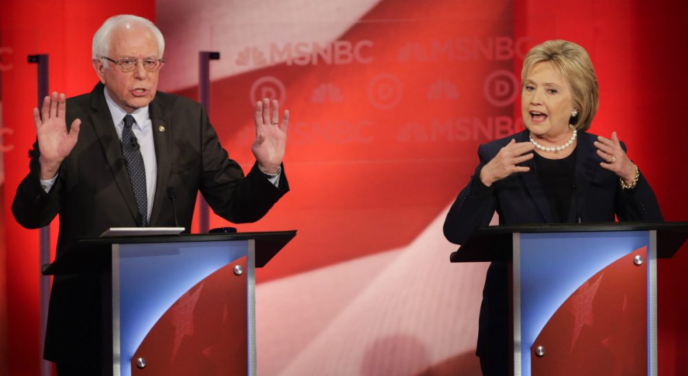 It's not just about the nomination, Clinton and Sanders are fighting for the heart of the Democratic party. Here, the two presidential candidates debate at the University of New Hampshire Thursday. (David Goldman/ AP)