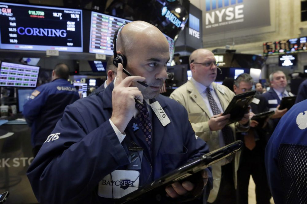 Trader Fred DeMarco, left, works on the floor of the New York Stock Exchange, Friday, Feb. 5, 2016.  Stocks moved moderately lower in early trading Friday after a report showed that U.S. job creation slowed last month. (Richard Drew/AP)