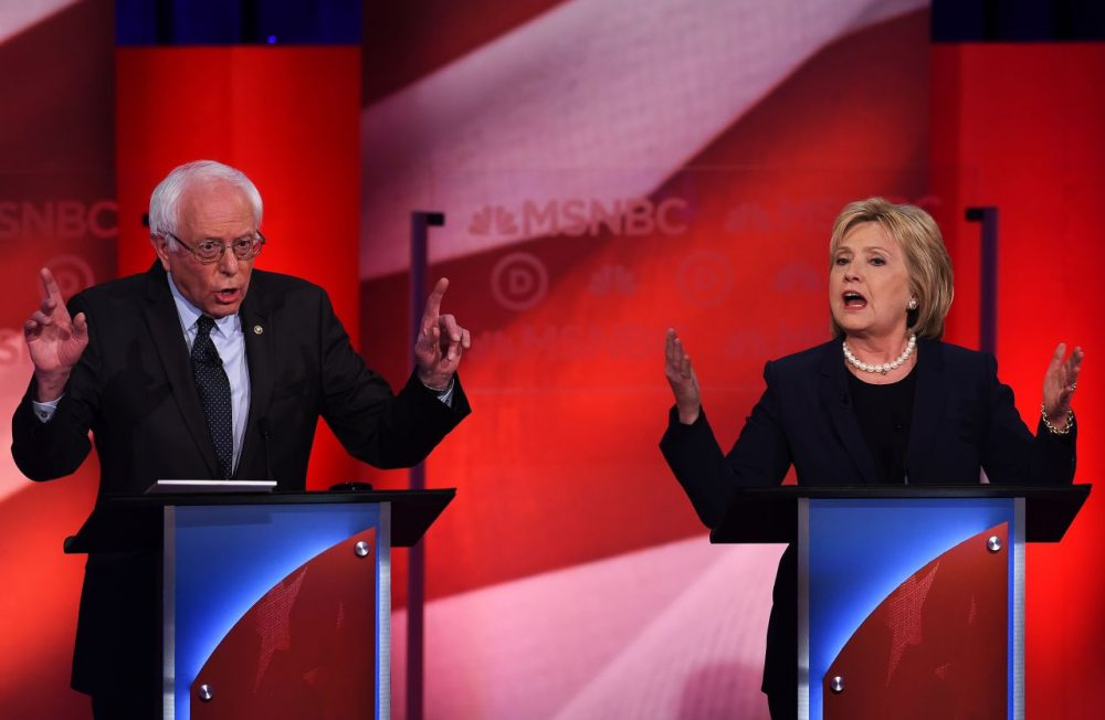 U.S. Democratic presidential candidates Bernie Sanders and Hillary Clinton participate in the MSNBC Democratic Candidates Debate at the University of New Hampshire in Durham on February 4, 2016.  (Jewel Samad/AFP/Getty Images)
