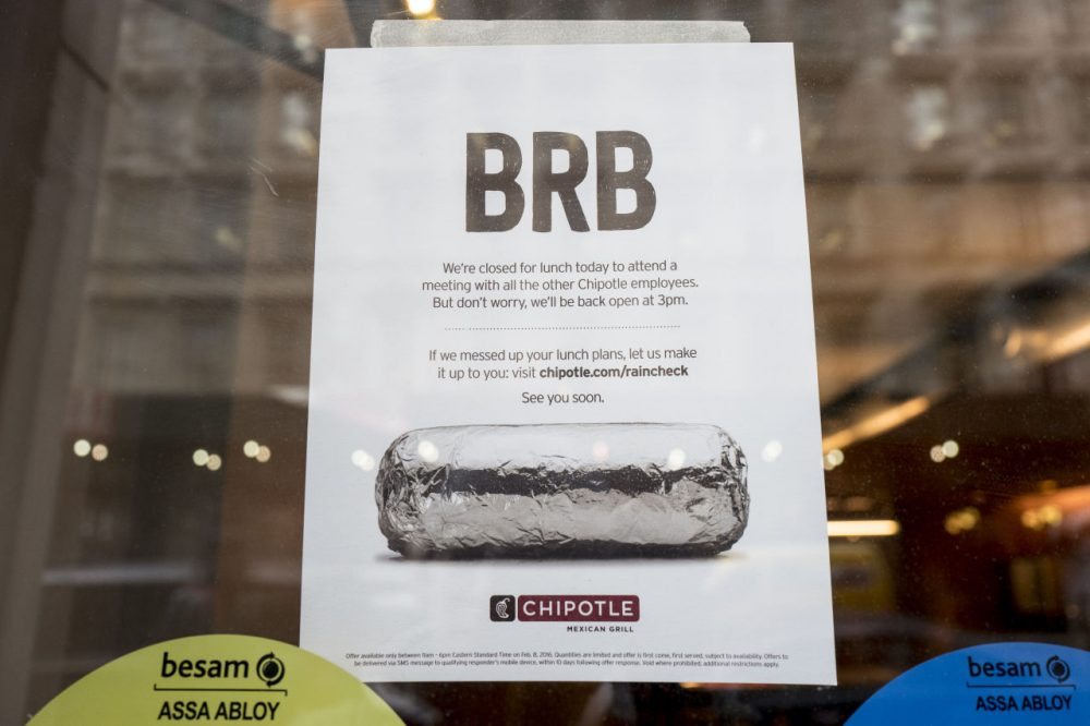 A sign sits in the window of a Chipotle restaurant on Broadway in Lower Manhattan telling customers the restaurant is closed until 3 p.m. on February 8, 2016 in New York City. The Mexican food chain is closing stores for lunch nationwide for a meeting on food safety following a number of E. coli outbreaks. (Andrew Renneisen/Getty Images)