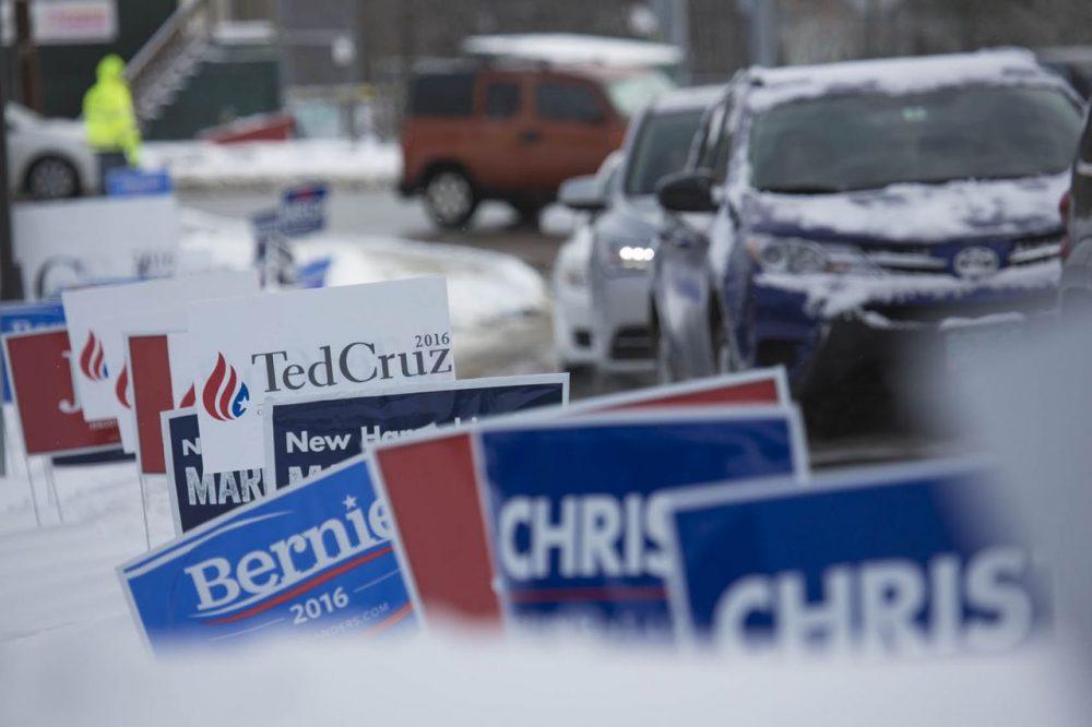 Cars funnel into Bedford High School to vote. (Jesse Costa/WBUR)