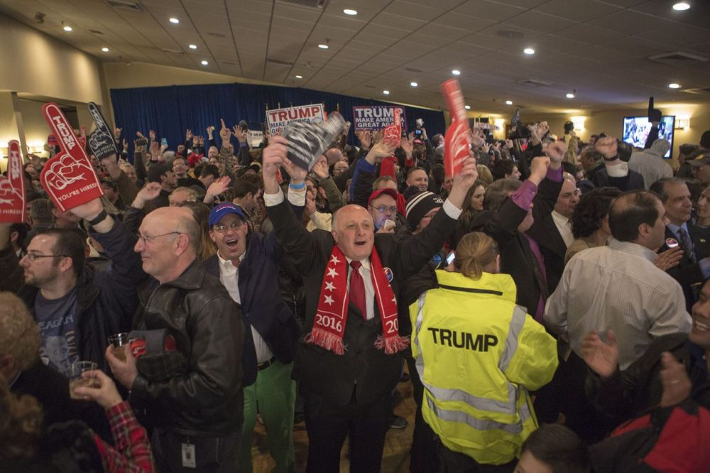 The crowd erupted as CNN called the New Hampshire Republican primary for Donald Trump. (Jesse Costa/WBUR)
