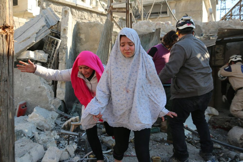 Syrian girls react following a reported Syrian regime air strike in a rebel-controlled area in the northern city of Aleppo on February 8, 2016. Regime forces backed by intense Russian air strikes have closed in on Aleppo city in their most significant advance since Moscow intervened in September in support of President Bashar al-Assad's government. (Ameer al-Halbi/AFP/Getty Images)