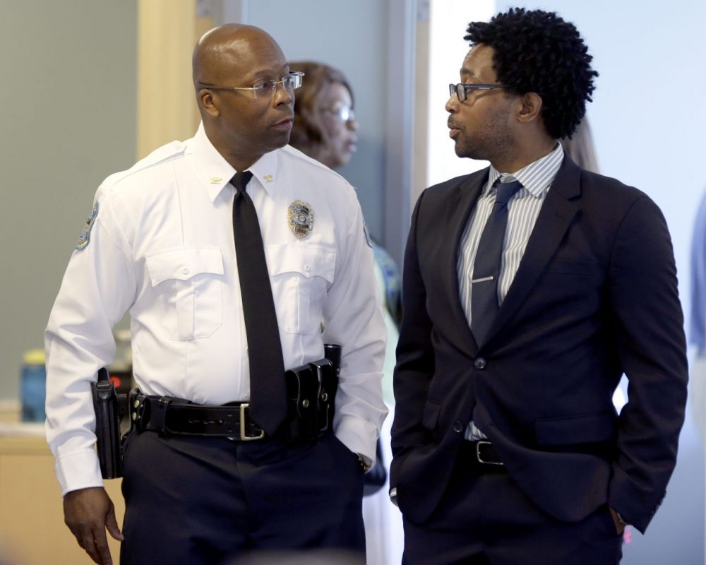 Andre Anderson speaks with Ferguson City Council member Wesley Bell, right, after being introduced as the the interim chief of the Ferguson Police Department during a news conference Wednesday, July 22, 2015, in Ferguson, Mo. (Jeff Roberson/AP)
