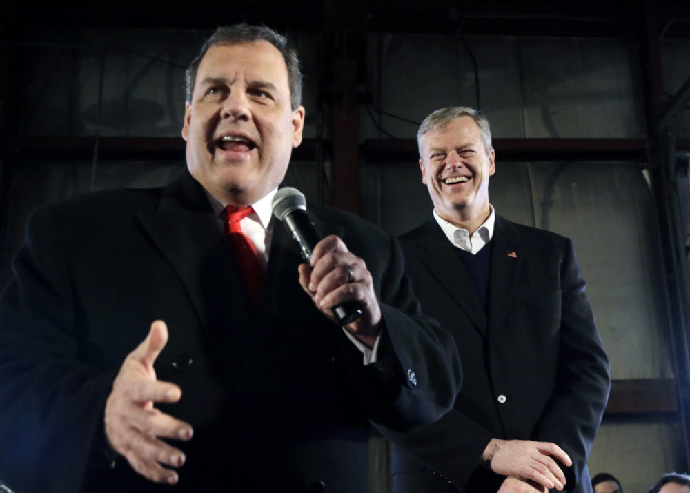 At a recent campaign event for Gov. Christie, who has since exited the presidential race, Baker laughs as the governor speaks before a crowd in Bedford, N.H. (Elise Amendola/AP)