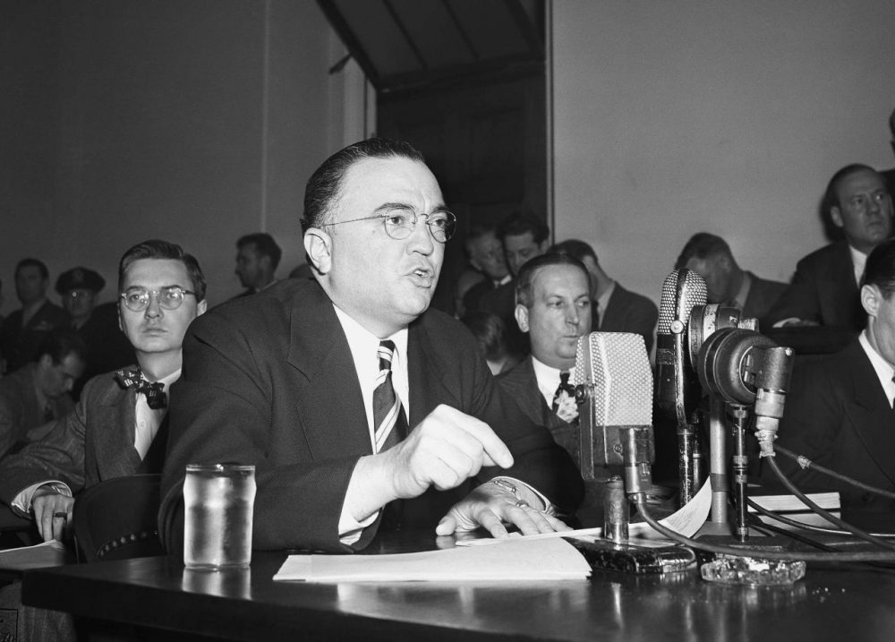 "J. Edger Hoover, director of the Federal Bureau of investigation, calls the communist party of the United States a ""fifth column"" whose ""goal is the overthrow of our government"" as he testifies in Washington in 1947 before the House Un-American activities committee. (AP)"