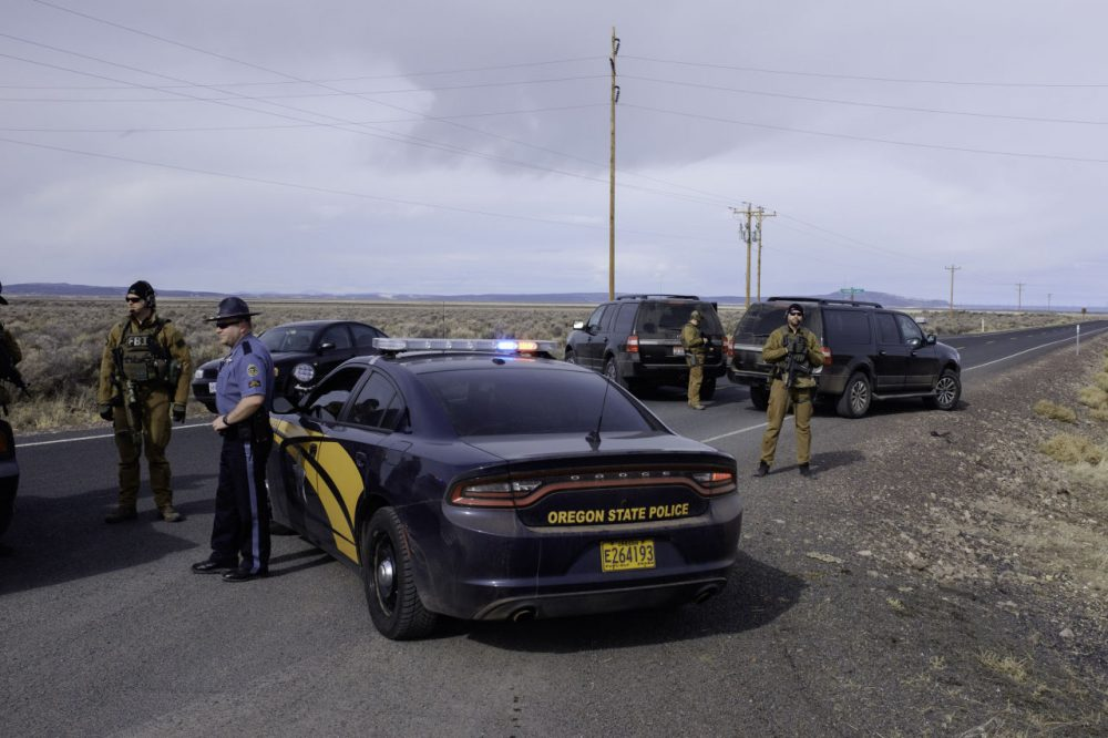 The FBI and Oregon State Police temporarily close a stretch of road near the Malheur Wildlife Refuge Headquarters near Burns, Oregon, on February 11, 2016.  The FBI surrounded the last protesters holed up at a federal wildlife refuge in Oregon amid reports they will surrender on Thursday, suggesting the weeks-long armed siege is approaching a climax. (Rob Kerr/AFP/Getty Images)
