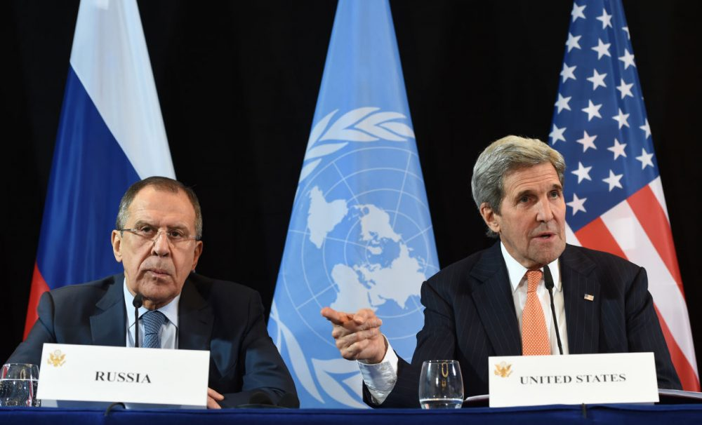 U.S. Secretary of State John Kerry (right) gestures beside Russian Foreign Minister Sergei Lavrov during a news conference after the International Syria Support Group (ISSG) meeting in Munich, Germany, on February 12, 2016.  (Christof Stache/AFP/Getty Images)