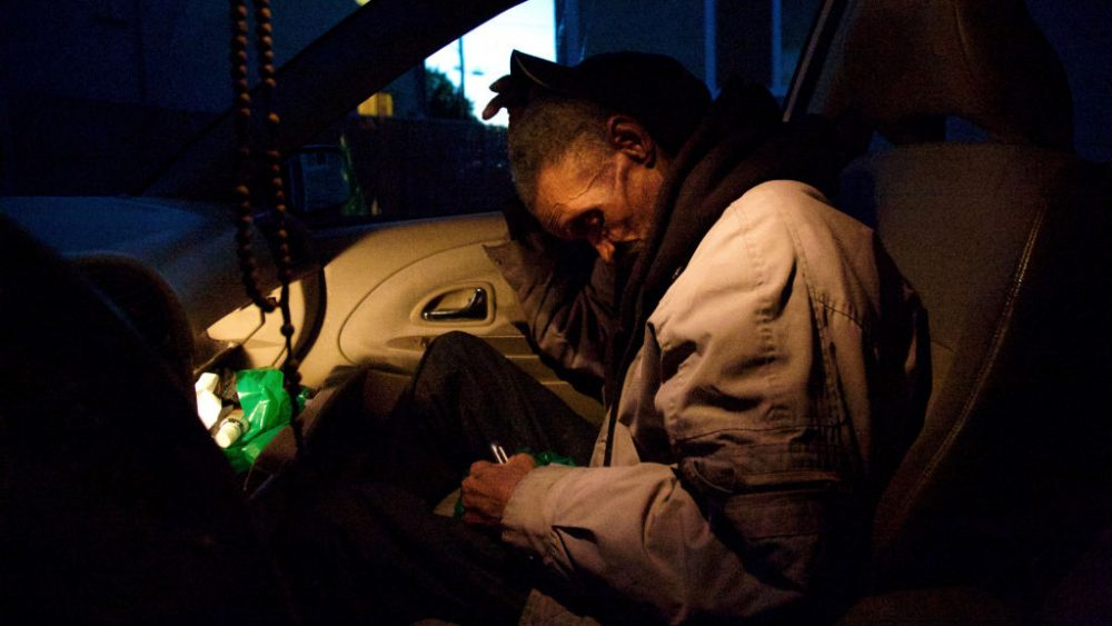 Dwane Foreman, 68, rests in his car in East Oakland, Calif. (ALISSA AMBROSE/STAT)