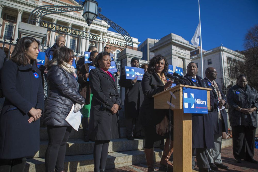 Surrounded by other minority leaders, Boston City Councilor Ayanna Pressley speaks at a State House rally Wednesday for Democratic presidential candidate Hillary Clinton. (Jesse Costa/WBUR)