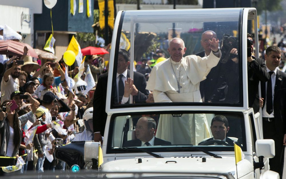 Pope Francis waves to the faithful upon his arrival in Morelia, Michoacán, on February 16, 2016.  Pope Francis arrived in Mexico's troublesome western state of Michoacan, where the cult-like Knights Templar drug cartel and its pseudo-messianic leader terrorized the population until farmers revolted against them. (Enrique Castro/AFP/Getty Images)