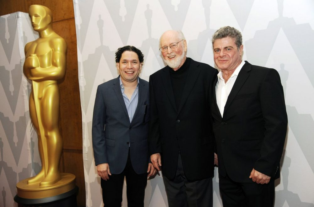 "Composers Gustavo Dudamel, left, John Williams, center, and Gustavo Santaolalla pose together at the Academy of Motion Picture Arts and Sciences event ""Behind the Score: The Art of the Film Composer."" (Chris Pizzello/Invision/AP)"