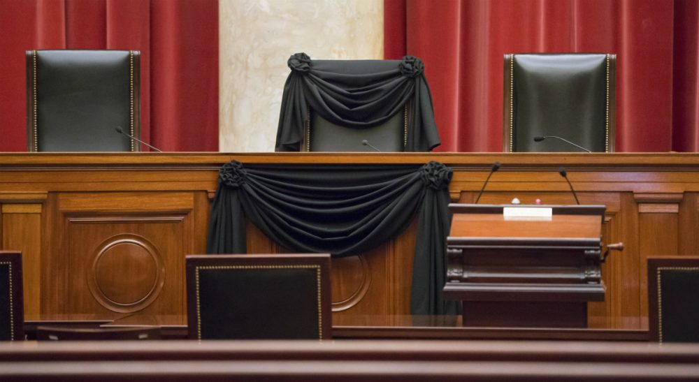 Steve Almond: Those who are distressed at Justice Scalia's passing should think about what it means that, not an hour after his death, they stood ready to defile all that he stood for. In this photo, Scalia's courtroom chair is draped in black to mark his death as part of a tradition that dates to the 19th century. Scalia died Feb. 13 at age 79. (J. Scott Applewhite/AP)