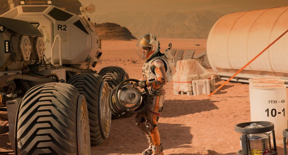 "Astronaut Mark Watney, played by Matt Damon, works to survive alone on Mars in ""The Martian."" (Courtesy 20th Century Fox)"