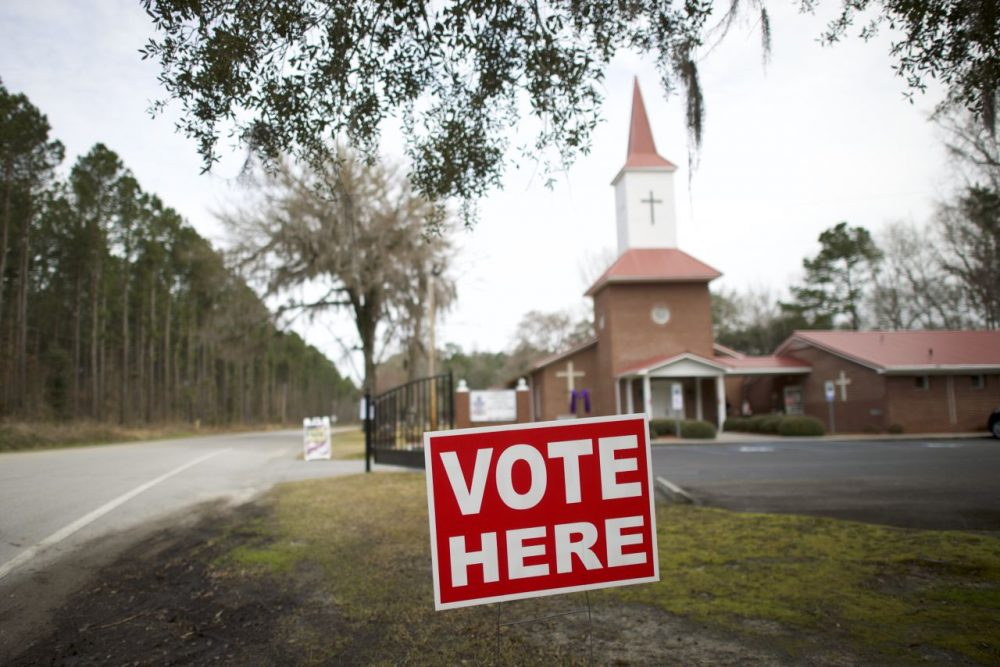"A ""Vote Here"" sign is positioned outside the Aimwell Presbyterian Church polling precinct on February 20, 2016 in Walterboro, South Carolina. (Mark Makela/Getty Images)"