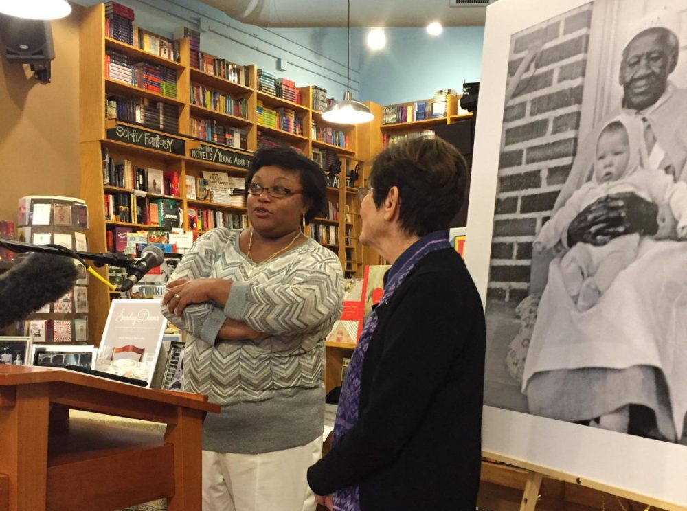 Andrea Scott, left, and Ann Walling speak at Parnassus Books. In the background is a photo of Andrea's great-great-great-grandmother Mary Scott holding Walling as a baby. (Kim Green)