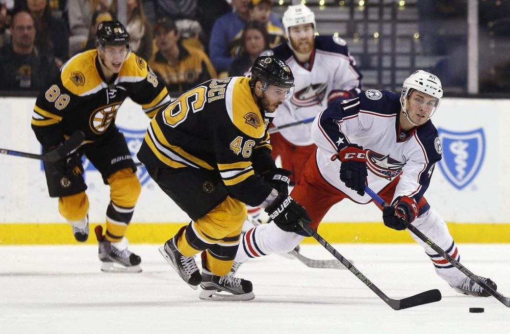 Boston Bruins' David Krejci (46) and Columbus Blue Jackets' Alexander Wennberg (41) battle for the puck during last night's game at the Garden. The Blue Jackets won 6-4. (Michael Dwyer/AP)