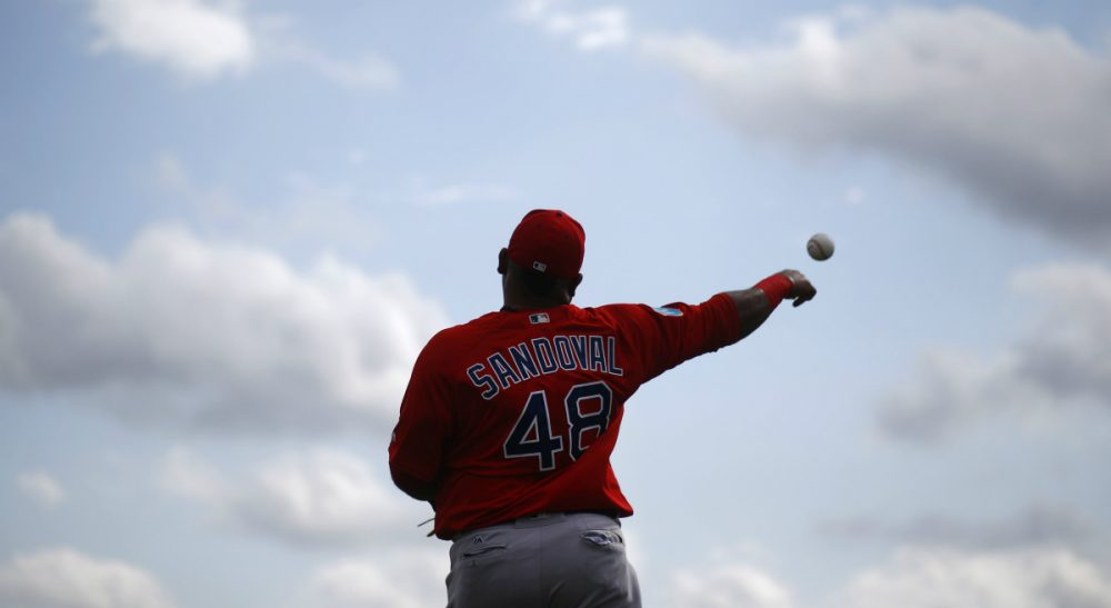 Boston Red Sox third baseman Pablo Sandoval throws a ball during a spring training baseball workout in Fort Myers, Fla., Wednesday, Feb. 24, 2016. (Patrick Semansky/AP)