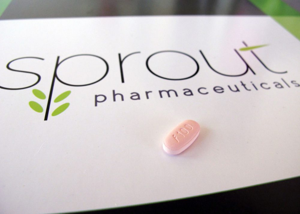 A tablet of flibanserin sits on a brochure for Sprout Pharmaceuticals in the company's Raleigh, N.C., headquarters. (Allen G. Breed/AP)