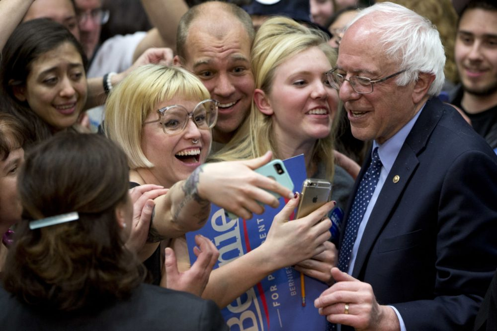 Democratic presidential candidate Sen. Bernie Sanders, I-Vt., greets people during a campaign rally at Colorado State University Sunday. (Jacquelyn Martin/AP)
