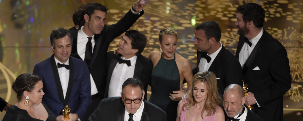 """Nicole Rocklin, from left, Michael Sugar, Blye Pagon Faust, Steve Golin, and cast and crew of """"Spotlight"""" accept the award for best picture for """"Spotlight"""" at the Oscars on Sunday. (Chris Pizzello/Invision/AP)"""