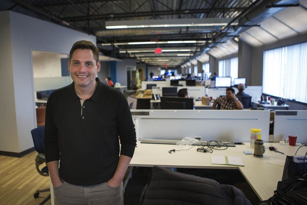 The CEO of Fuze, formerly ThinkingPhones, Steve Kokinos, stands in the company's offices that are rapidly getting too small, thanks to the company's sudden growth. (Jesse Costa/WBUR)