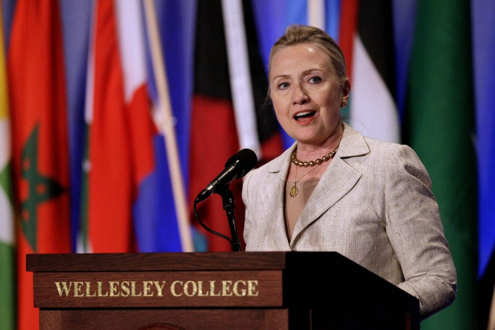 Then-Secretary of State Hillary Clinton speaks at her alma mater, Wellesley College, in this 2012 file photo. In 2016, the school is split on supporting Clinton and her rival for the Democratic presidential nomination, Bernie Sanders. (Stephan Savoia/AP)