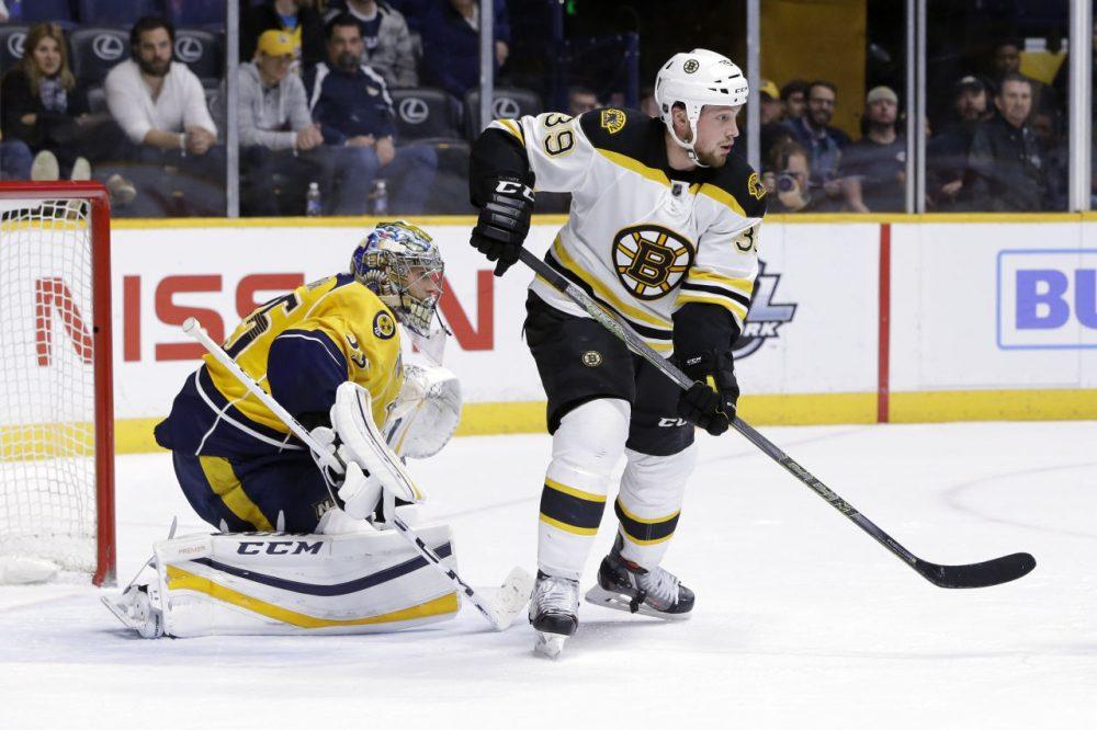 Bruins left wing Matt Beleskey (39) and Nashville Predators goalie Pekka Rinne (35), of Finland, play in Thursday's game in Nashville, Tennessee. (Mark Humphrey/AP)