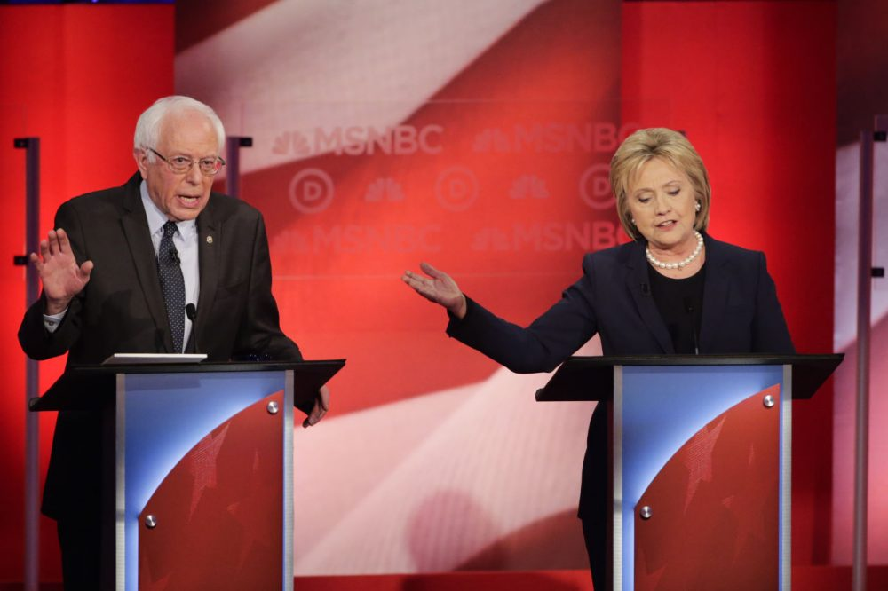 The last WBUR poll before the New Hampshire primary finds Bernie Sanders holding a 15-point lead over Hillary Clinton. Here, the two Democrats debate at the University of New Hampshire Thursday. (David Goldman/AP)