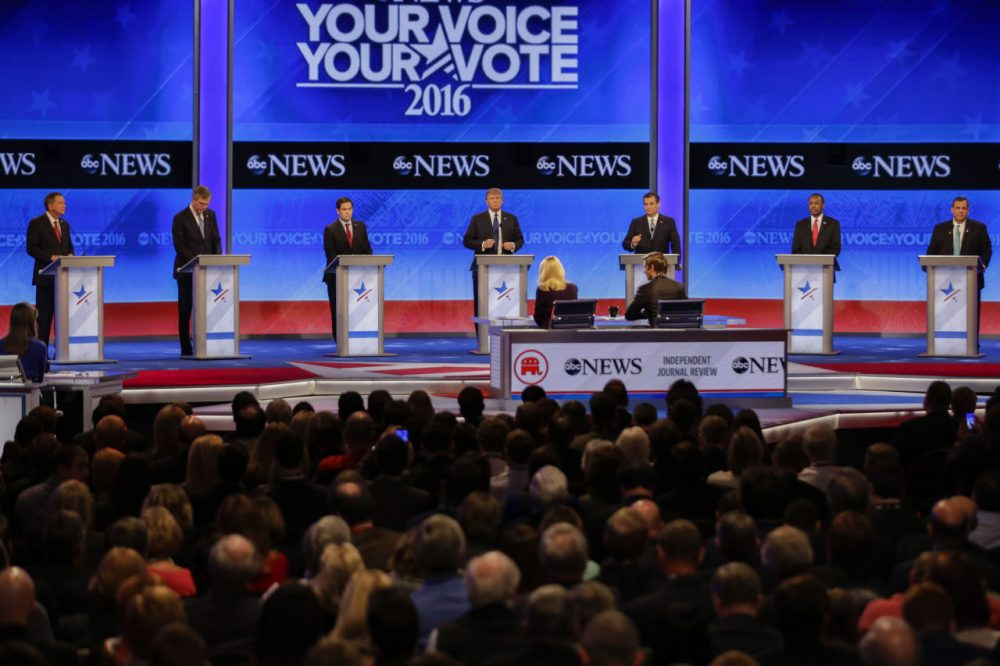 Republican presidential candidates line up on stage at the beginning of a debate hosted by ABC News at St. Anselm College  Saturday in Manchester. (David Goldman/AP)