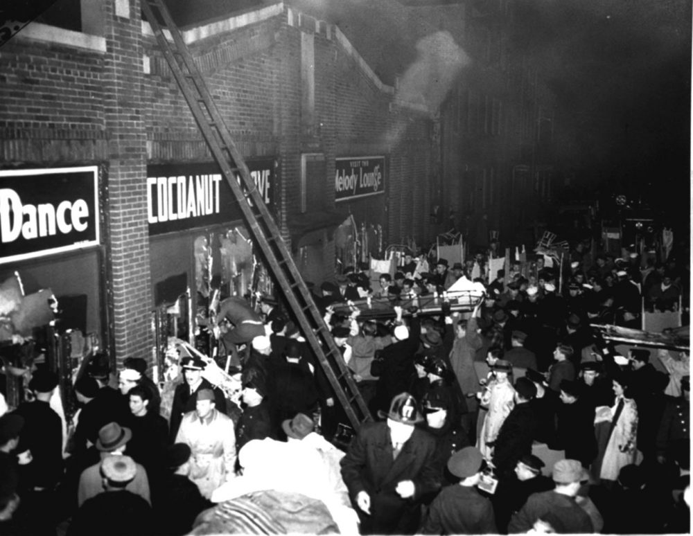 Boston fire and police department workers and many servicemen jam the street outside the Cocoanut Grove nightclub on November 28, 1942.  (AP Photo)