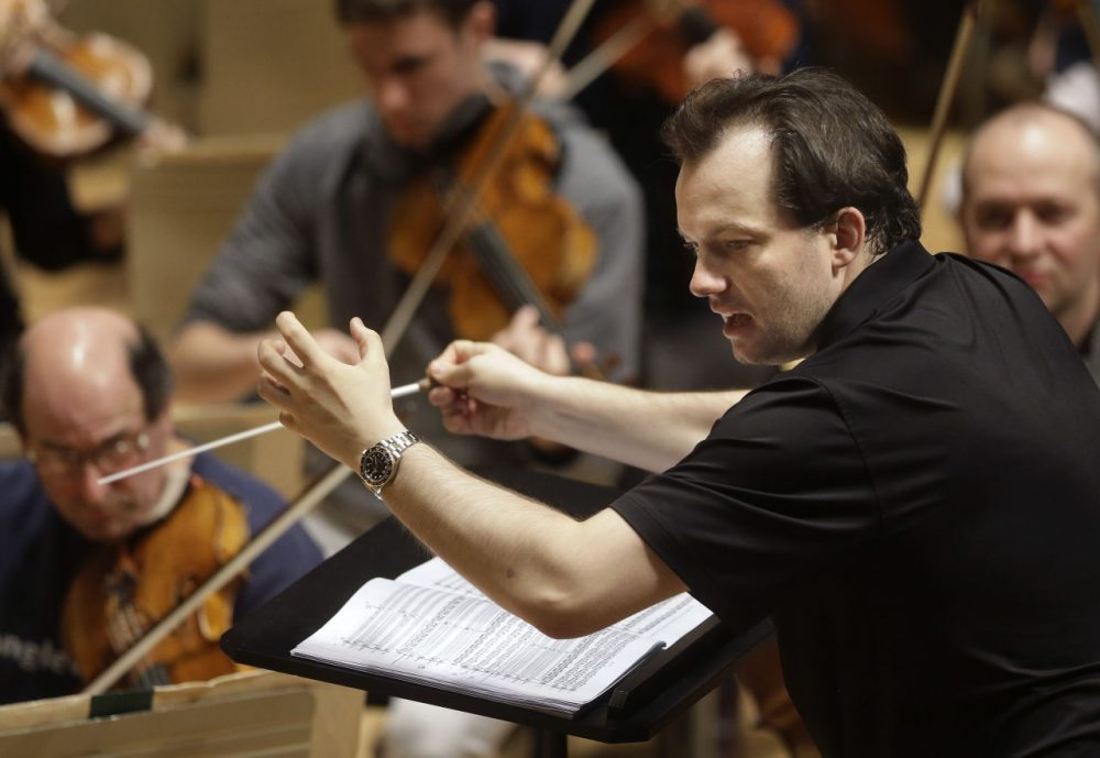 """In this 2014 file photo, Boston Symphony Orchestra music director Andris Nelsons rehearses at Symphony Hall. The BSO won the orchestral performance Grammy for """"Shostakovich Under Stalin's Shadow,"""" on Monday. It was the orchestra's first recording in a new partnership with the Deutsche Grammophon label, and its seventh Grammy overall. (Steven Senne/AP)"""