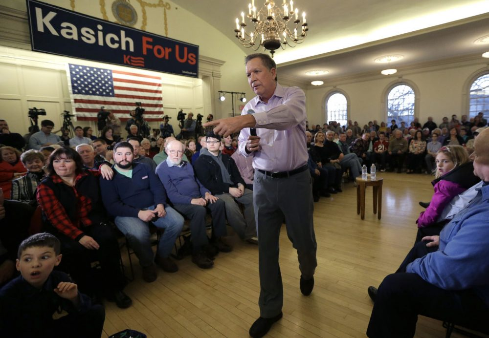 Republican presidential candidate, Ohio Gov. John Kasich, takes questions from the audience while holding a town hall event Monday in Plymouth. (Steven Senne/AP)