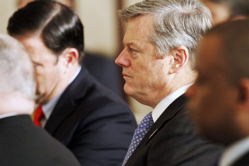 Gov. Charlie Baker listens as President Obama speaks during a meeting with fellow governors at the White House on Monday. The governors spoke about the opioid addiction crisis. /Jacquelyn Martin/AP)