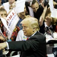 Republican presidential candidate Donald Trump gestures as he signs autographs at a campaign event Sunday, Feb. 21, 2016, in Atlanta. (David Goldman/AP)