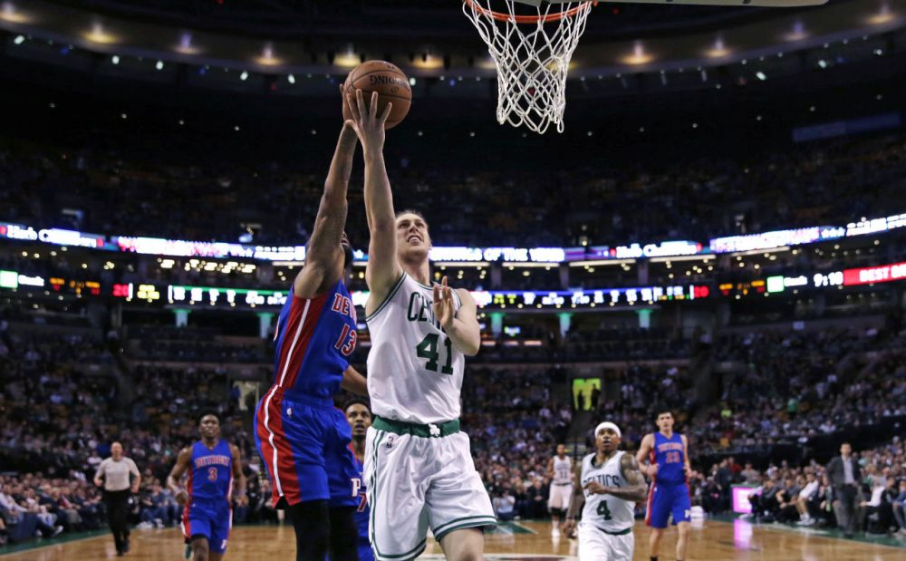 Celtics center Kelly Olynyk drives to the basket past Pistons forward Marcus Morris during the second half Wednesday night. The Celtics defeated the Pistons 102-95. (Charles Krupa/AP)