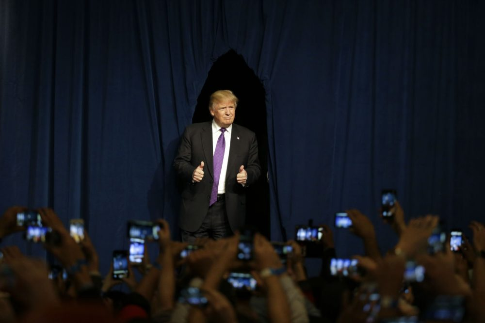 Republican presidential candidate Donald Trump arrives for a caucus night rally Tuesday in Las Vegas. Trump won the state handily and is well ahead of GOP rivals in Massachusetts, according to the WBUR poll. (Jae C. Hong/AP)