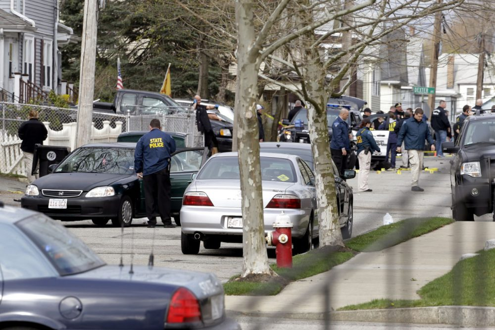 The scene in Watertown on April 19, 2013, after the Boston Marathon bombers engaged in a violent gunfight with police on a quiet residential street. One of the suspects was killed, the other escaped before being captured several hours later hiding in a covered boat in a nearby backyard. (Matt Rourke/AP)
