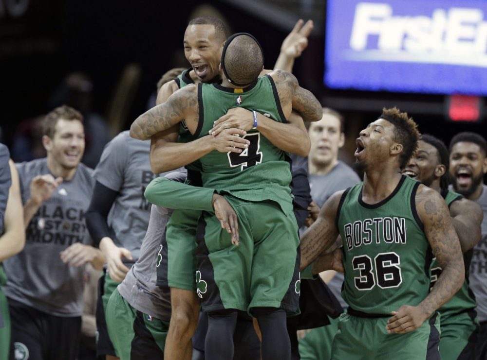 Celtics' Avery Bradley, top, and Isaiah Thomas hug after the Celtics defeated the Cleveland Cavaliers 104-103 in a game Friday in Cleveland. Bradley made a corner jumper at the horn to give the Celtics the win.(Tony Dejak/AP)