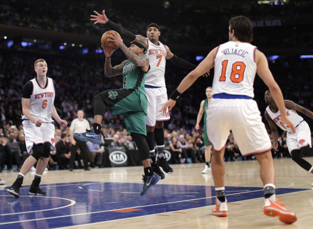 Boston Celtics guard Isaiah Thomas drives through the New York Knicks defense during the third quarter of the game. (Julie Jacobson/AP)