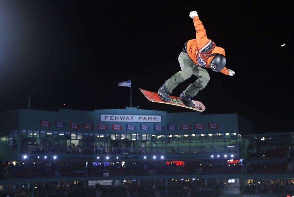 Snowboarder Michael Schaerer, of Switzerland, jumps during the Big Air at Fenway skiing and snowboarding U.S. Grand Prix tour event. (Elise Amendola/AP)