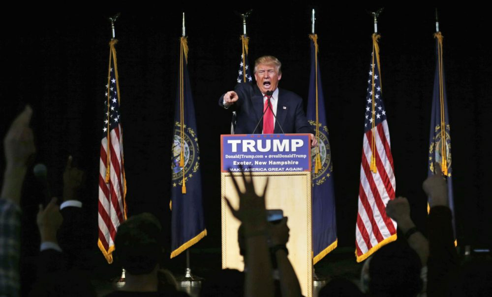 Republican presidential candidate Donald Trump takes questions during a campaign stop at Exeter Town Hall in Exeter, N.H., Thursday, Feb. 4, 2016. (AP Photo/Charles Krupa)