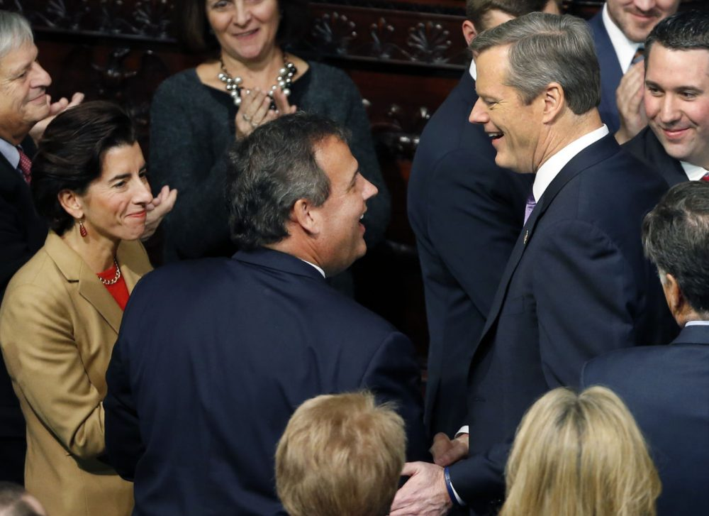 In this January 2015 file photo, Gov. Charlie Baker, right, greets New Jersey Gov. Chris Christie and Rhode Island Gov. Gina Raimondo, far left, at the State House in Boston, prior to Baker's inauguration. (Elise Amendola/AP)