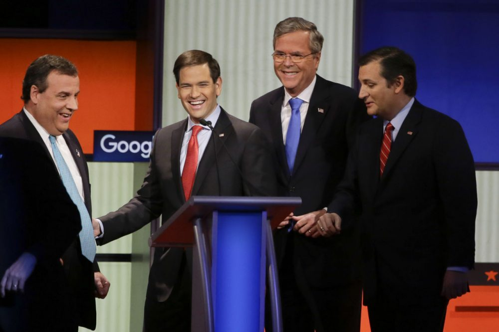 Republican presidential candidates Gov. Chris Christie, Sen. Marco Rubio, former Florida Gov. Jeb Bush and Sen. Ted Cruz, talk after a debate on Jan. 28 in Des Moines, Iowa. (Charlie Neibergall/AP)