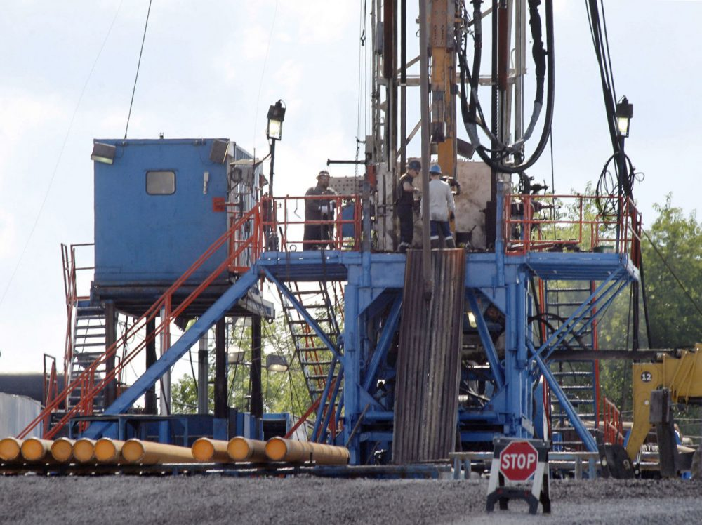 The Baker administration is counting on natural gas from Pennsylvania. In this 2012 file photo, a crew works on a drilling rig at a well site for shale-based natural gas in Zelienople, Pa. (Keith Srakocic/AP)