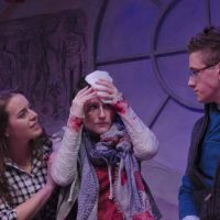 Melissa Jesser (left) as Em, Amanda Collins as Cassie (center) and Evan Horwitz as Sean (right) react after an attack by a fraternity brother. (Kalman Zabarsky/Boston Playwright's Theatre)